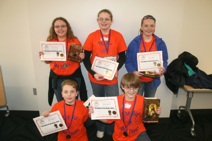 "First Place: ""The Big Book Theory"" – Front (L to R): Aidan Burnside, Caleb Summers. Back: Carissa King, Olivia Stone, Emily Miller."