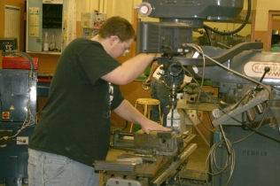 Casey Jenkins works on PET components in Machine Metals class.