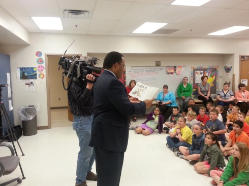 "Marcus McIntosh from KCCI reads to Franklin fourth graders as part of the KCCI/EMC Insurance ""Read with Me"" program."
