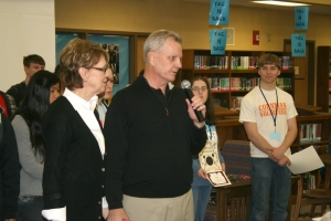 Jennifer and J.P. Howard, owners of the Tremont, recognize MHS students with perfect third quarter attendance Wednesday afternoon in the MHS Library.