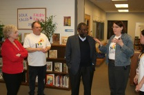 Rogers teacher LuAnn Lura discusses Rogers University and Family Learning Center with Ralph Smith.