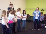 Students participate in improv comedy between Battle of the Books rounds.