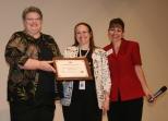 Principal Bea Niblock, Food Services Director Vickie McVey and USDA official Darlene Sanchez.