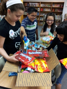 Third Grade students at Woodbury helped pack up seven Woodbury Cares packages to the service men and women in the platoon of their teacher, Petty Officer Richard Ortega, who is serving in Afghanistan.