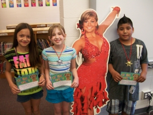 Top three medalists (L to R): Beyonce Corona, Cassandra Ralston, and Roman Gonzalez with a cutout of  2012 Olympian and native Iowan Shawn Johnson.