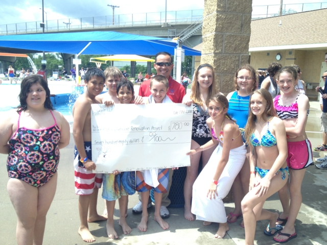 Lenihan ELP students present MHS principal Aiddy Phomvisay with a check for $780 toward the Roundhouse renovation.