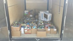 Nearly 1,000 food items were donated at the Blue/White Classic Friday, Aug. 23.