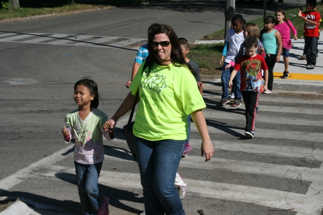 Students and staff from Rogers Elementary walk to the National Guard Armory on Monday as part of the Healthiest State Initiative.