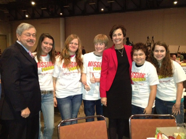 Marshalltown High School students Trey Quick, Mikela Jones, Kailey Miller, Isabella Pedersen, and River Bown attended the Governor's Summit on Bullying Monday in Des Moines. The students are pictured above with Gov. Terry Branstad and Lt. Gov. Kim Reynolds.