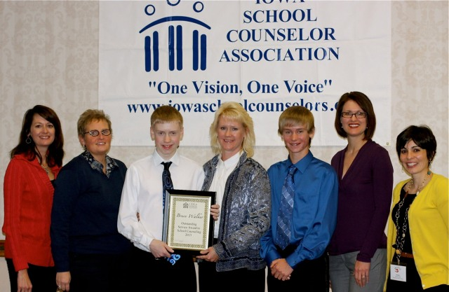 Members of the Walker family and counselors from Marshalltown Schools accept the 2013 Outstanding Service Award on behalf of the late Bruce Walker.