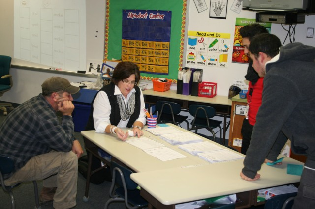 Hoglan teacher Amy Pollard shows parents learning activities they can do at home with their kids.