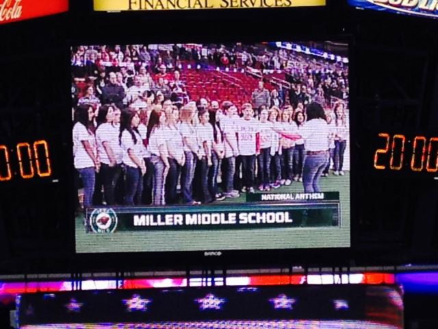 Miller Middle School students sing the National Anthem at the Iowa Wild Hockey game Sunday, Nov. 3, in Wells Fargo Arena, Des Moines.