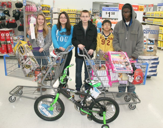 Five Miller Middle School eighth grade students purchased gifts for those in need Thursday at Walmart with money raised by the entire class. Pictured with the toys purchased are, from left, Macey Lolwing, Jazmin Ibarra, David Barlow, Cody Songkhamdet and Demiko Deng.
