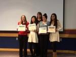 L to R: Emily Murtha, Kim-mee Schmitt, teacher Rachel Nelson-Loupee, Maria Marroquin Perez, Melisa Fonseca.