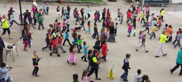 Rogers Elementary students dance on Go the Distance Day.