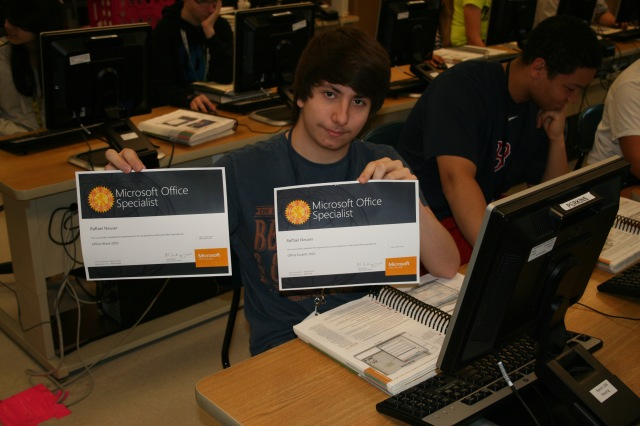 Raffael Nueser holds two of his three MOS certificates.