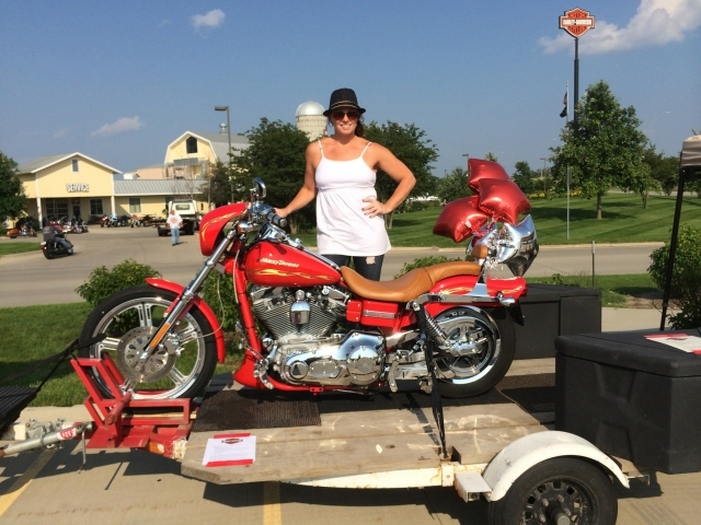 Jocie DiIorio, Chairperson for the Ridin' for the Roundhouse Raffle, is pictured with the custom-edition Harley-Davidson Dyna Wide Glide II.