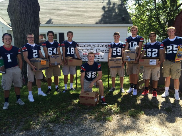 Members of the Marshalltown High School Football Team dropped off 344 non-perishable food items at the Emergency Food Box last week, all proceeds from the annual Blue & White Classic football scrimmage.