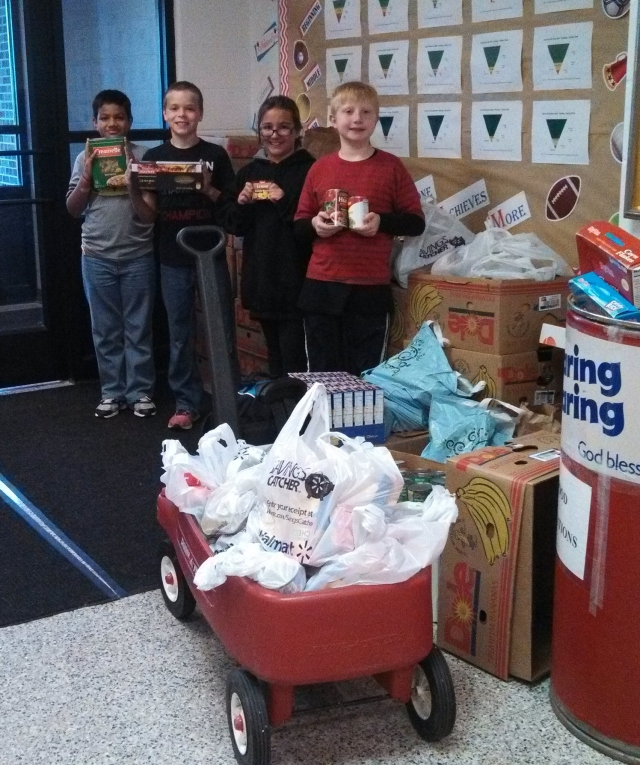Hoglan students show off the proceeds of the food drive.