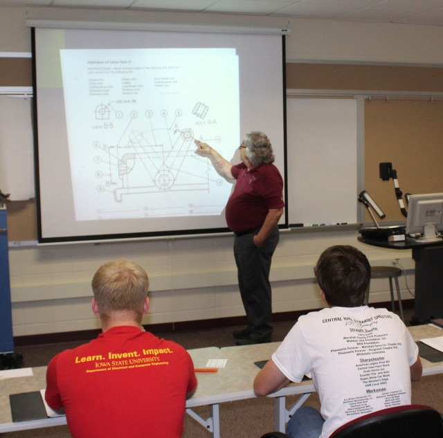 Mhs students learn manufacturing field as part of emerson summer jimmy richardson goes over the basics of a blueprint with the internship class on june 7 malvernweather Image collections