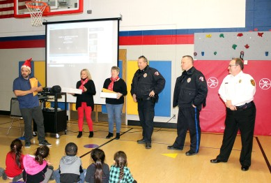 Three public safety leaders were gifted snacks and letters by Hoglan students last week, including Marshalltown Police Lt. Rick Bellile, center, Marshalltown Police Chief Mike Tupper, second from right, and Marshalltown Fire Chief David Rierson, right.